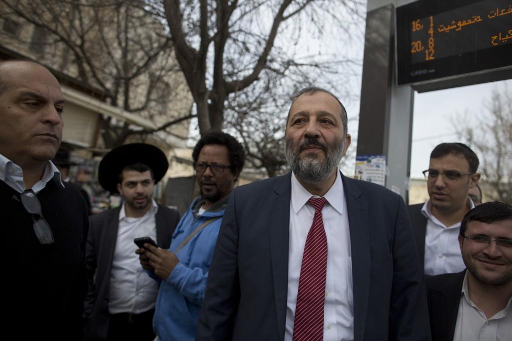 Israeli Interior Minister Aryeh Deri ( C ) is seen during a visit in a bus station in Jerusalem , on February 01, 2016. Photo by Lior Mizrahi/Flash90 *** Local Caption *** àøéä ãøòé ùø äôðéí ùñ úçðú àåèåáåñ øôåøîä äåæìä