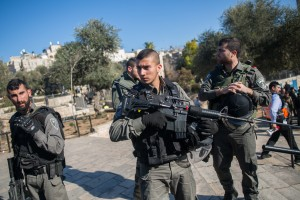 Israeli security forces guard at the scene of Wednesday's attack. (Yonatan Sindel/Flash90)