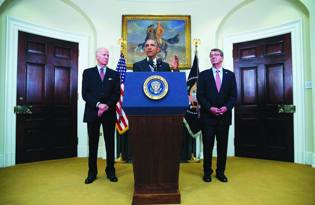 President Barack Obama (C) discusses administration plans to close theGuantanamo military prison while delivering a statement at the White House in Washington Tuesday. Standing with the president are Vice President Joe Biden (L) and Defense Secretary Ash Carter. (Carlos Barria/Reuters)