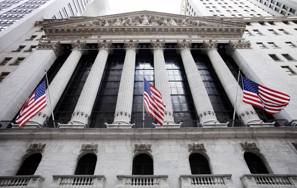American flags fly in front of the New York Stock Exchange. (AP Photo/Mark Lennihan, File)