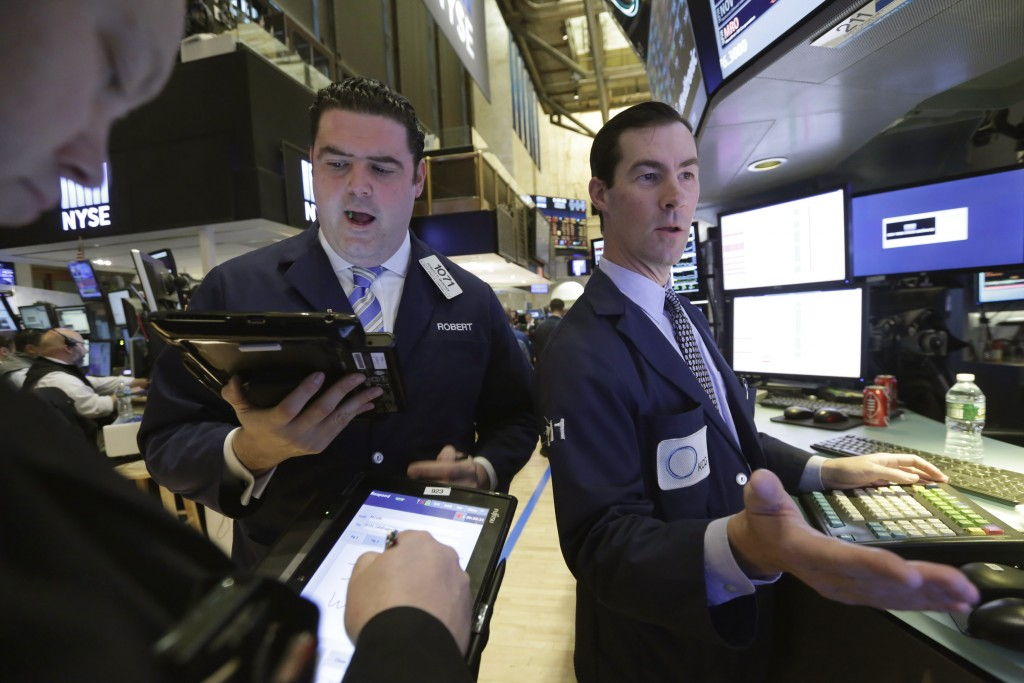 Trader Robert McQuade and specialist John McNierney, right, work on the floor of the New York Stock Exchange on Wednesday. (AP Photo/Richard Drew)