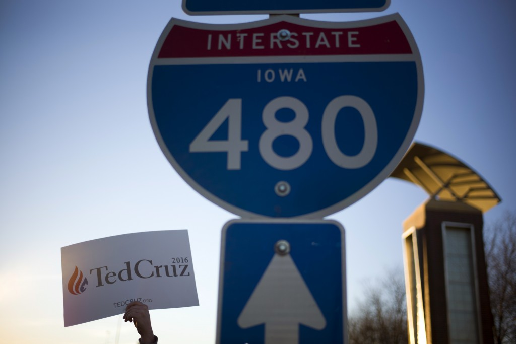 A Cruz supporter holds a sign on a highway, in Council Bluffs, Iowa. (AP Photo/Jae C. Hong)
