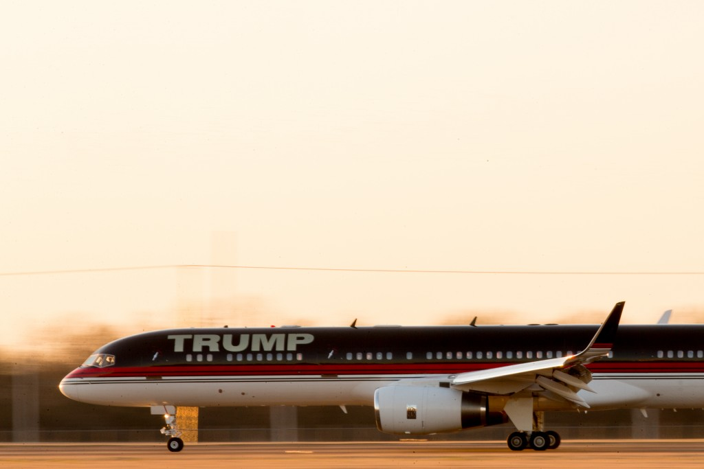 The plane carrying Republican presidential candidate Donald Trump lands for a rally at Millington Regional Airport in Millington, Tenn., Saturday, Feb. 27, 2016. (AP Photo/Andrew Harnik)