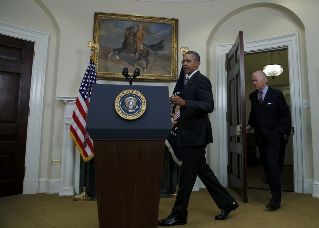 U.S. President Barack Obama (C), followed by Vice President Joe Biden, arrives to deliver a statement  on administration plans to close the Guantanamo military prison, at the White House in Washington February 23, 2016. Obama had pledged to close the facility at the U.S. naval base at Guantanamo Bay, Cuba, since he took office in 2009. REUTERS/Carlos Barria