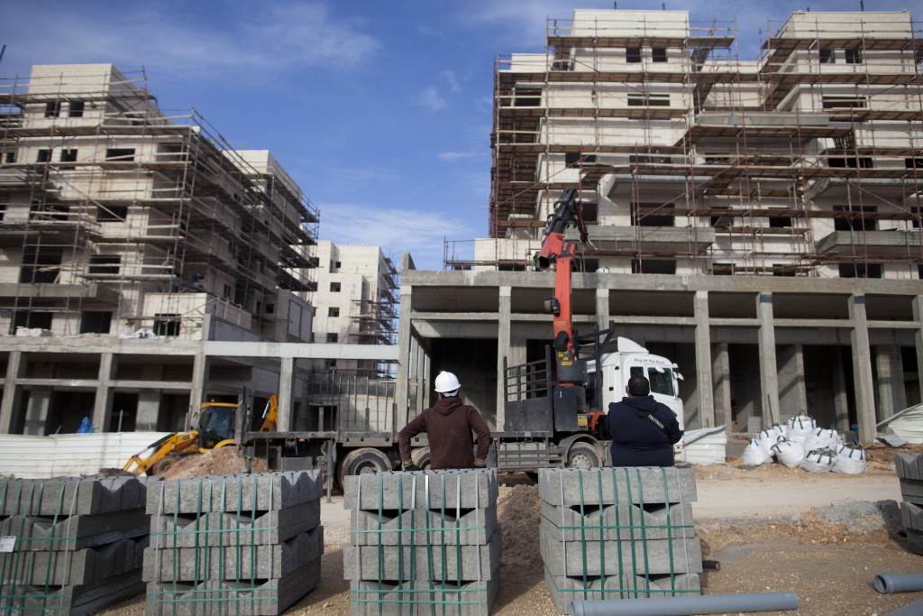 Construction of new residential buildings in the northern Israeli city of Harish, for religious and secular occupants. (Lior Mizrahi/Flash90)