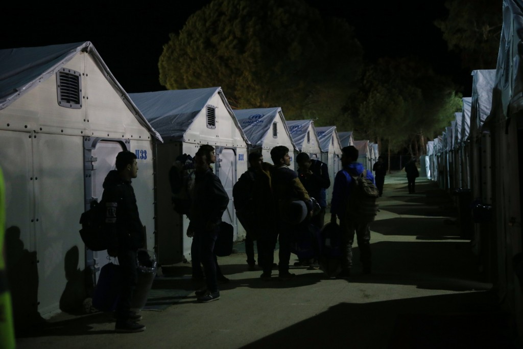 Refugees arrive at a registration and hospitality center on the Greek island of Lesbos on Tuesday. (AP Photo/Petros Giannakouris)