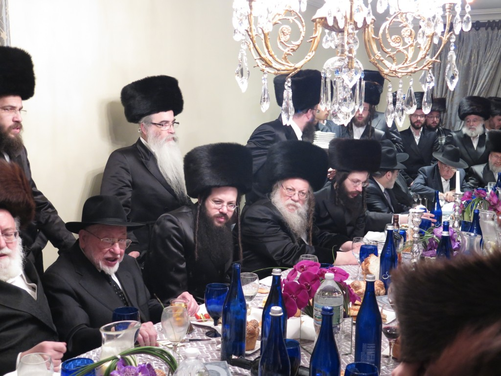 Modzitzer Rebbe Motzei Shabbos by Melavah Malkeh, Also Seen, The famous Baal minaginim ,R' Ben Zion Shenker and R' Abish Brodt. (JDN)