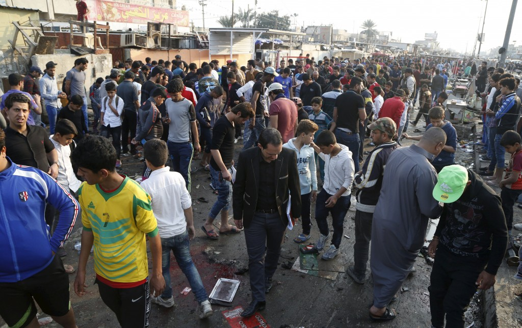People gather at the site of suicide blasts in Baghdad's Sadr City February 28, 2016. The death toll from two suicide blasts in Baghdad's mainly Shi'ite district of Sadr City rose to 24 with more than 60 others wounded, police and medical sources said on Sunday. REUTERS/Wissm al-Okili TPX IMAGES OF THE DAY