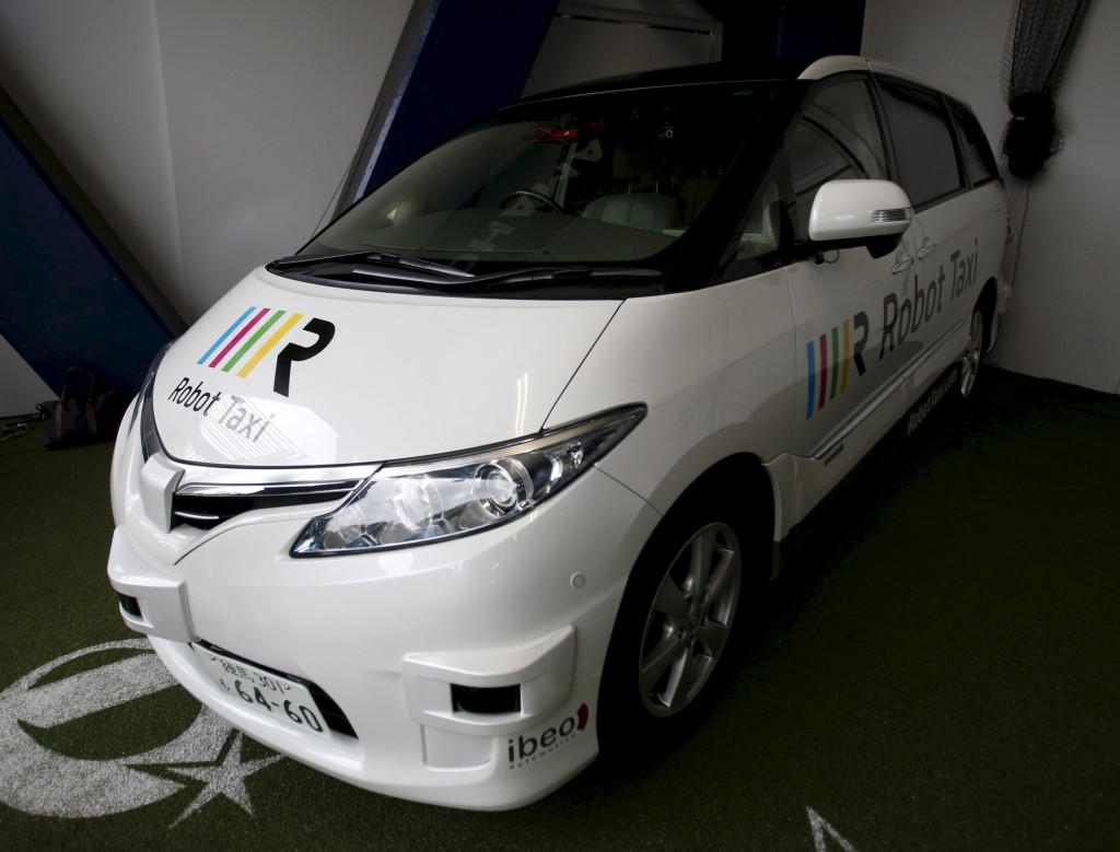 Robot Taxi Inc.'s Robot Taxi, a self-driving taxi based on a Toyota Estima car body, is seen during an unveiling ceremony in Yokohama, south of Tokyo, Japan, October 1, 2015 file photo. Japan's Robot Taxi aims to forge partnerships with carmakers to develop a driverless taxi service in time for the 2020 Olympics, the technology company said, holding its first tests on public roads and joining a global race to develop self-driving cars. REUTERS/Yuya Shino/Files