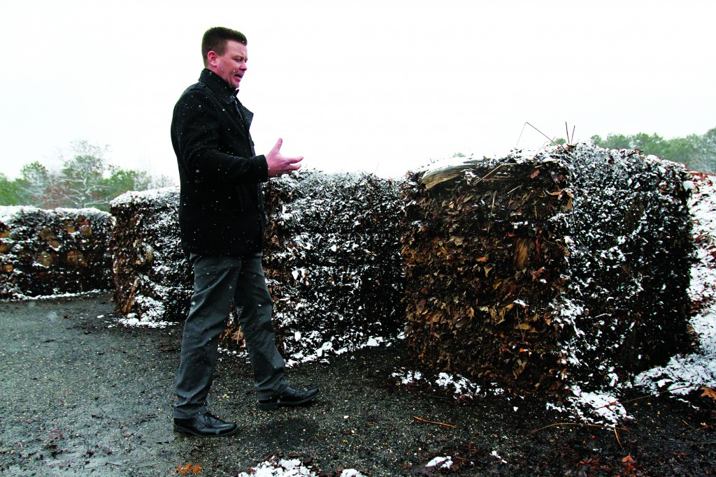 Patrick Donnelly, Little Egg Harbor's superintendent of Public Works, stands last week next to bales of composted leaves that were used to hold back storm waters. (Viviana Pernot/The Press of Atlantic City via AP)