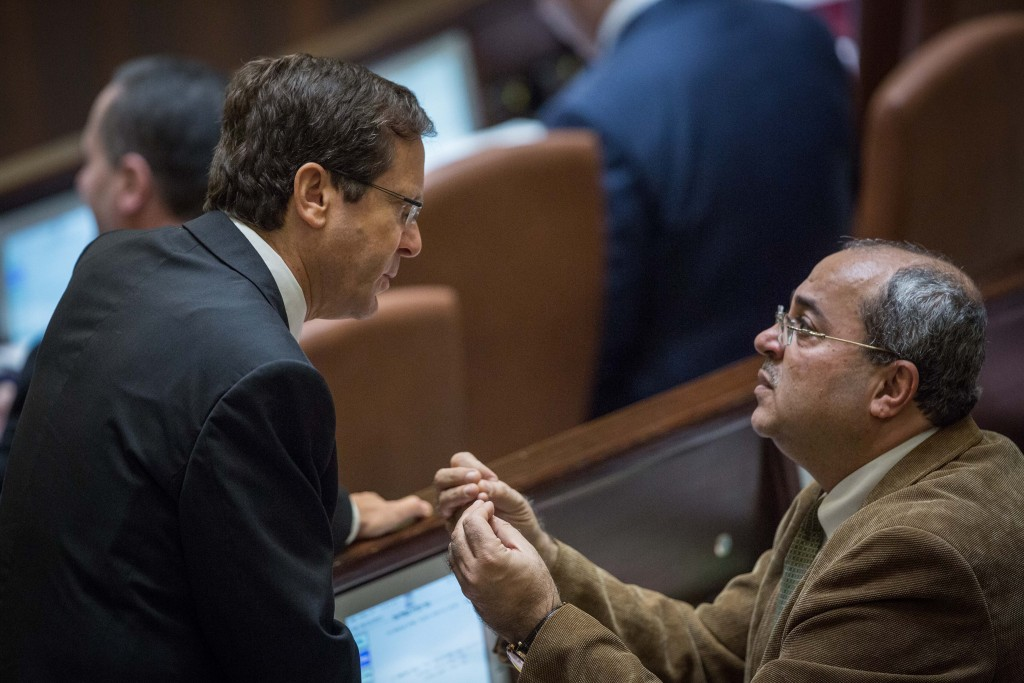 MK Ahmad Tibi, seen here speaking at the Knesset with opposition leader Isaac Herzog. (Hadas Parush/Flash90)