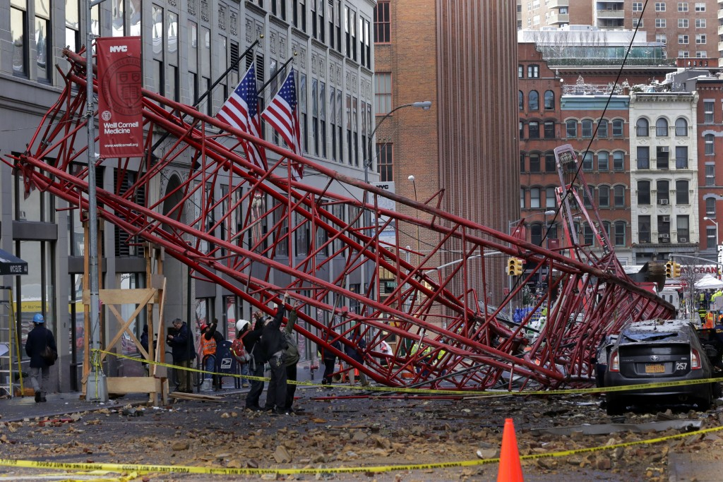 Officials survey the scene of Friday's deadly crane collapse. (AP Photo/Richard Drew)