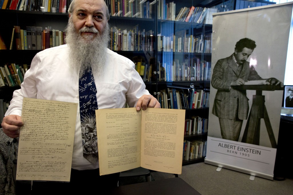 Hebrew University's Roni Gross holds the original historical documents related to Albert Einstein's prediction of the existence of gravitational waves, at the Hebrew university in Yerushalayim on Thursday. (AP Photo/Sebastian Scheiner)