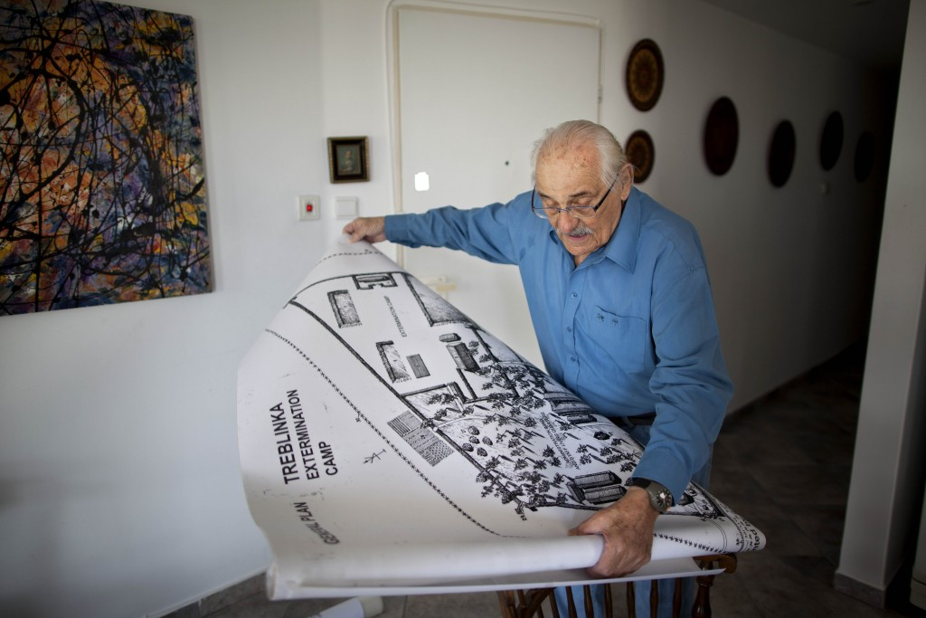 FILE -- In this Oct. 31, 2010 file photo, Holocaust survivor Samuel Willenberg displays a map of Treblinka extermination camp during an interview with the Associated Press at his house in Tel Aviv, Israel. Willenberg, the last survivor of Treblinka, the Nazi death camp where 875,000 people were killed, has died, Friday, Feb. 19, 2016, at 93. Willenberg was among a group of Jews who in 1943 set fire to the camp and headed to the woods. Hundreds fled, but most were killed by Nazi troops in the surrounding mine fields or captured by Polish villagers. (AP Photo/Oded Balilty, File)
