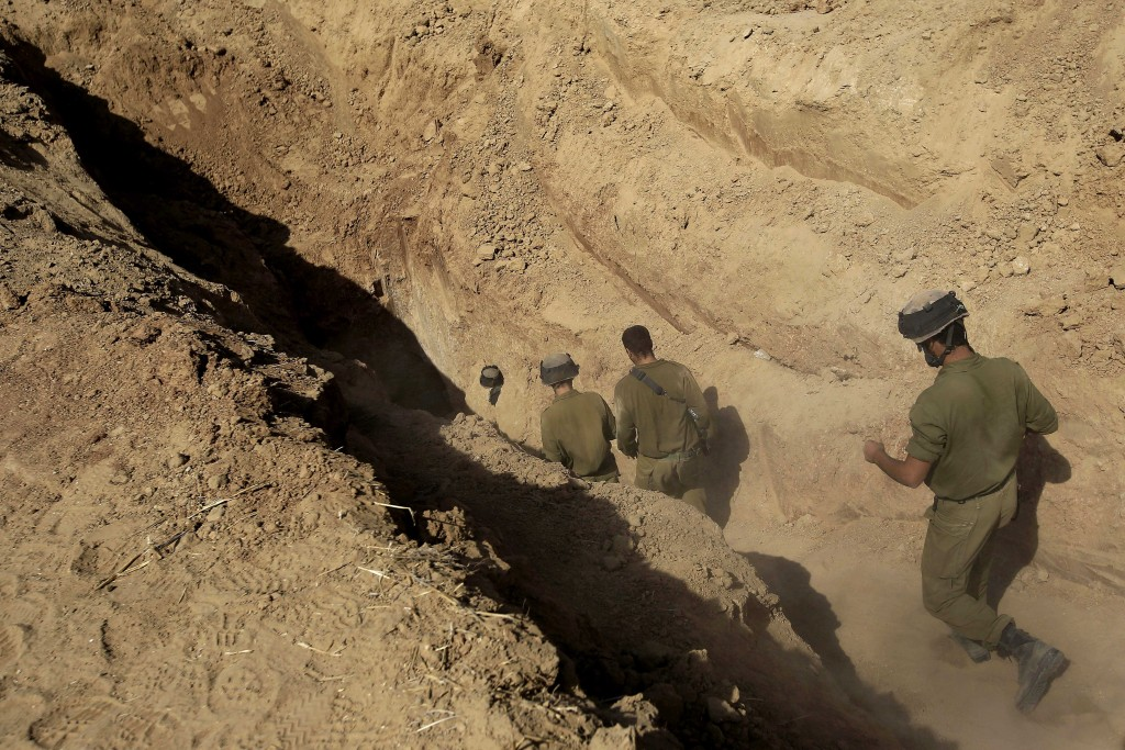 FILE - In this Sunday, Oct. 13, 2013 file photo, Israeli soldiers enter a tunnel discovered near the Israel Gaza border. Israel's military chief Lt. Gen. Gadi Eisenkot said Tuesday, Feb. 9, 2016, that Gaza's Hamas rulers have been rebuilding the sophisticated network of underground tunnels that Israel damaged during the 2014 war. Eisenkot said destroying this network is the military's top priority for 2016. (AP Photo/Tsafrir Abayov)