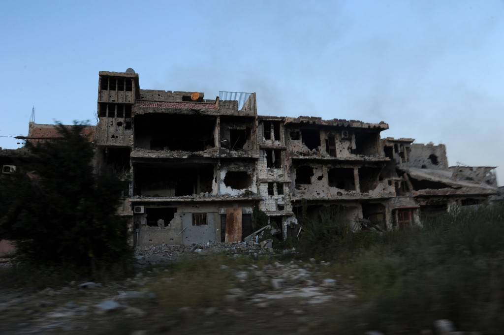 In this picture taken Tuesday, Feb. 23, 2016, a damaged building is seen in Benghazi, Libya. Army units, backed by civilian fighters, cleared a major part of the eastern city of Islamic extremists Tuesday, following nearly two years of deadly fighting. (AP Photo/Mohammed el-Shaiky)