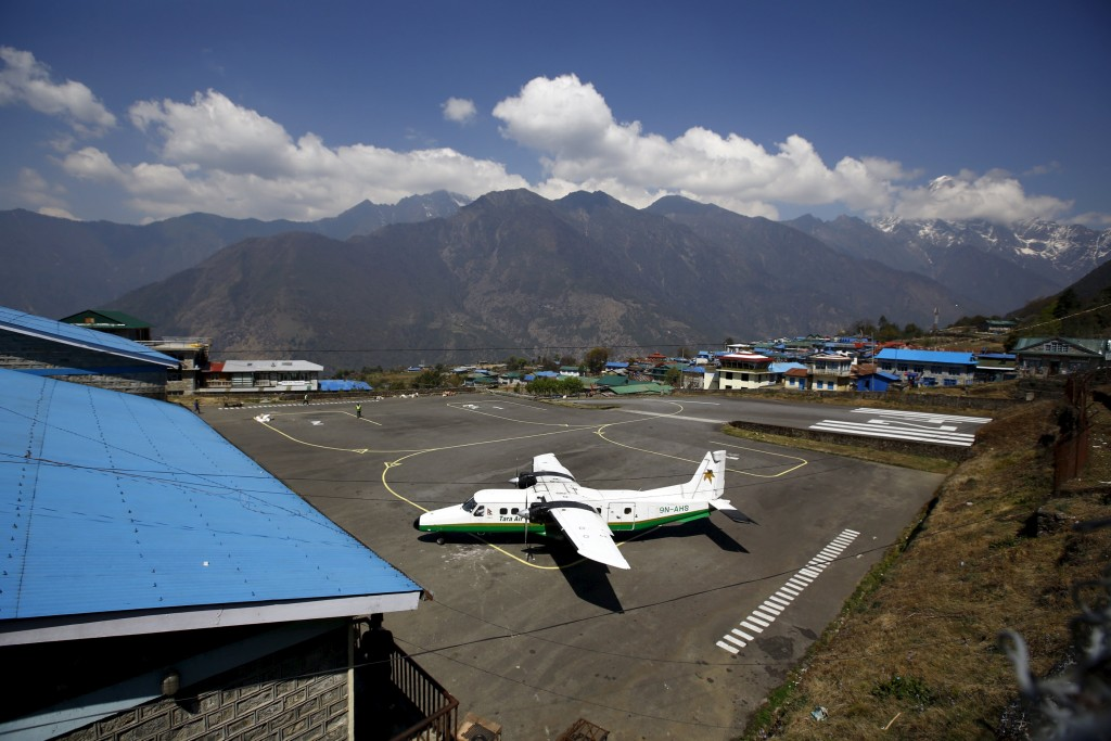 A Twin Otter aircraft belonging to Tara Air is pictured at Tenzing Hillary Airport, in Lukla, approximately 2800 meters above sea level, in Solukhumbu district, Nepal, in this file picture taken April 25, 2014. A Twin Otter aircraft, operated by Tara Air, carrying 21 people including two foreigners, has gone missing in west Nepal, an airport official said on February 24, 2016. The plane pictured here is not the plane that was involved in the crash. Picture taken April 25, 2014. REUTERS/Navesh Chitrakar/Files