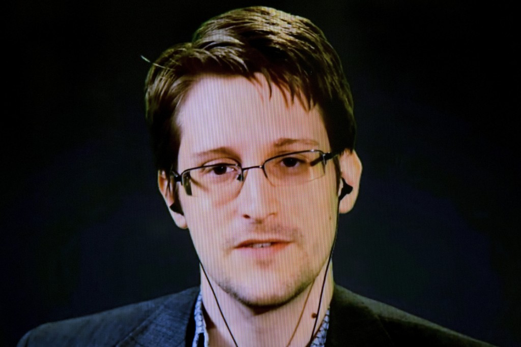 American whistleblower Edward Snowden delivers remarks via video link from Moscow to attendees at a discussion regarding an International Treaty on the Right to Privacy, Protection Against Improper Surveillance and Protection of Whistleblowers in Manhattan, New York in this September 24, 2015 file photo. REUTERS/Andrew Kelly/Files