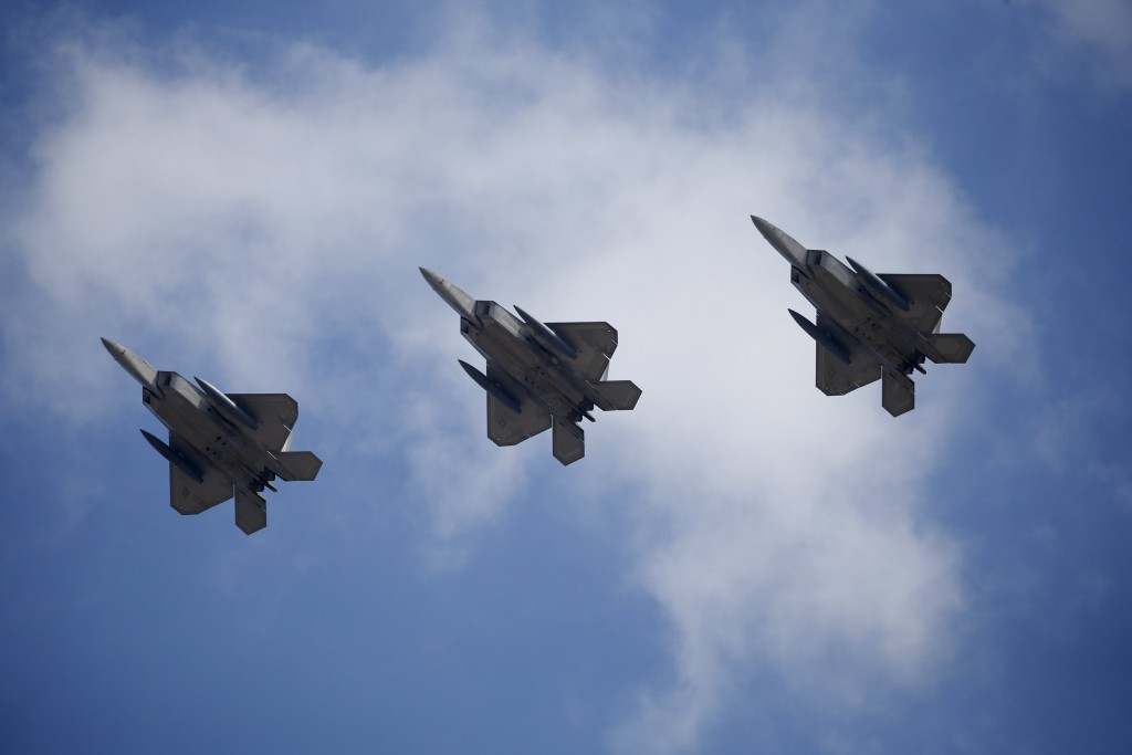 U.S. F-22 stealth fighter jets fly over Osan Air Base in Pyeongtaek, South Korea, February 17, 2016. REUTERS/Kim Hong-Ji