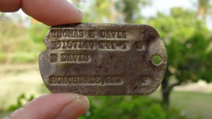 Pfc. Thomas E. Davis's Army dog tag that was found in a farm field in Saipan in early 2014. (Genevieve Cabrera via AP)