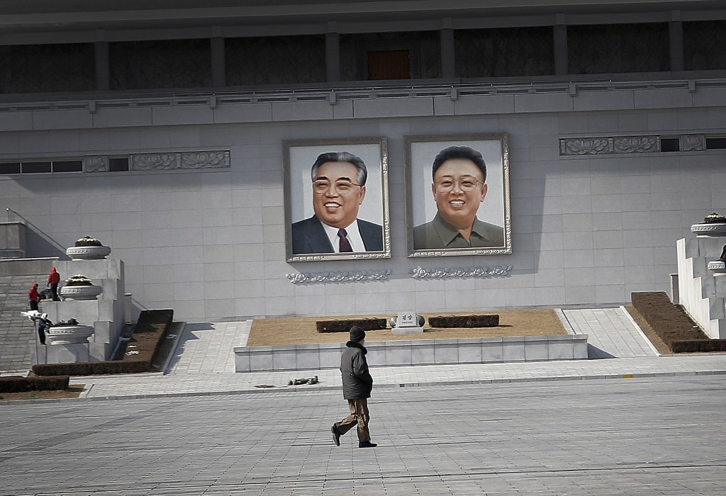 "A man walks past portraits of the late North Korean leaders Kim Il Sung and Kim Jong Il, at the Kim Il Sung Square on Sunday, Feb. 14, 2016, in Pyongyang, North Korea. North Korea launched a rocket Feb. 7, carrying what it said was an Earth observation satellite into space. The U.N. Security Council condemned North Korea's launch of a long-range rocket that world leaders called a banned test of ballistic missile technology and another ""intolerable provocation."" The U.N.'s most powerful body pledged to quickly adopt a new resolution with ""significant"" new sanctions. (AP Photo/Wong Maye-E)"