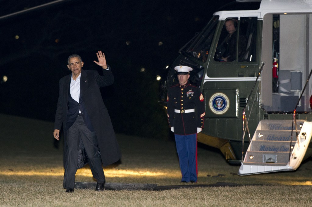 President Barack Obama waves as he walks from Marine One across the South Lawn to the White House in Washington, Tuesday, Feb. 16, 2016, in Washington, as he returned from California after a two-day summit with leaders of Southeast Asian nations. (AP Photo/Carolyn Kaster)