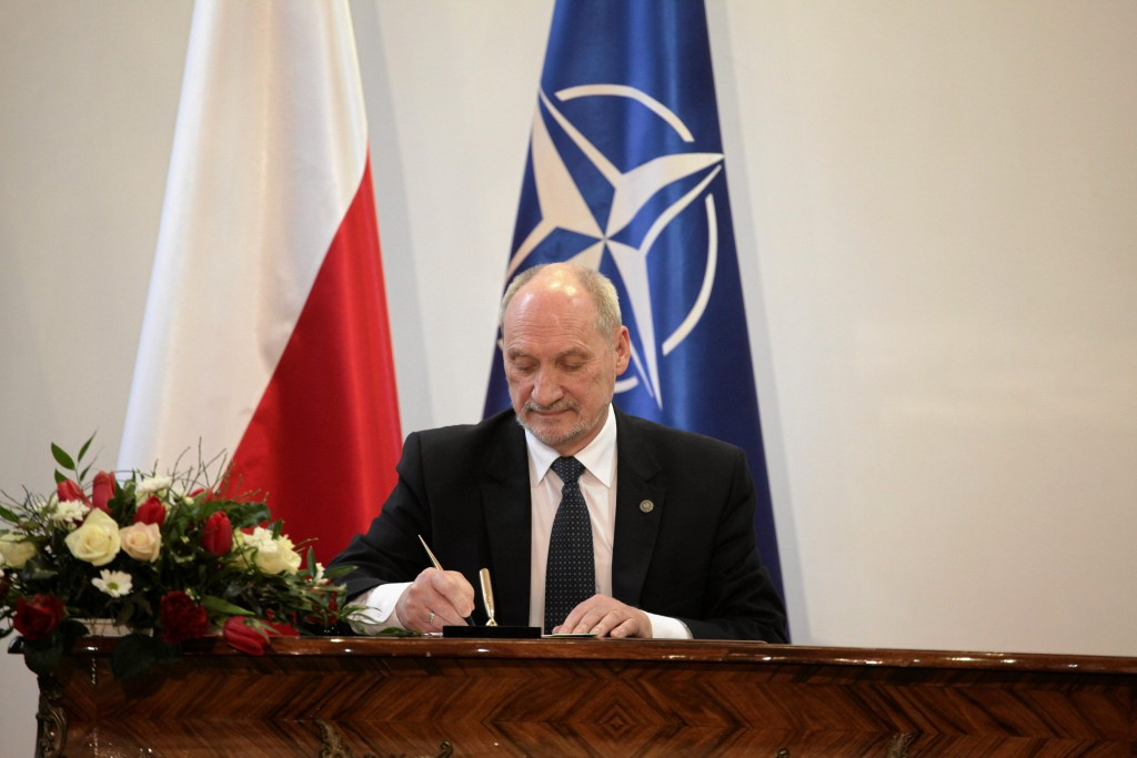 Defence Minister Antoni Macierewicz signs a document during a ceremony to announce the decision of relaunching an inquiry into the death of President Lech Kaczynski in a plane crash in Russia in 2010, in Warsaw, Poland February 4, 2016. Poland's new government on Thursday relaunched an inquiry into the death of President Lech Kaczynski in a plane crash in Russia in 2010, a move likely to strain Warsaw's relations with its former overlord, already fragile over the Ukraine crisis. REUTERS/Slawomir Kaminski/Agencja Gazeta ATTENTION EDITORS - THIS IMAGE WAS PROVIDED BY A THIRD PARTY. FOR EDITORIAL USE ONLY. NOT FOR SALE FOR MARKETING OR ADVERTISING CAMPAIGNS. THIS PICTURE IS DISTRIBUTED EXACTLY AS RECEIVED BY REUTERS, AS A SERVICE TO CLIENTS. POLAND OUT. NO COMMERCIAL OR EDITORIAL SALES IN POLAND.