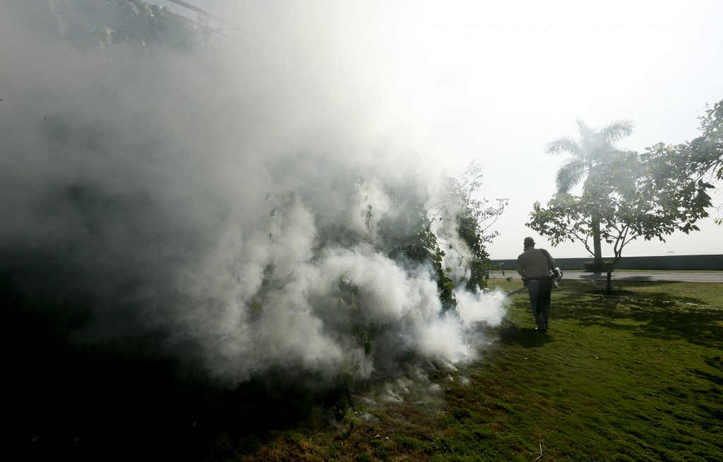 A health ministry worker fumigates for Aedes aegypti mosquitoes, vector for the spread of the Zika virus, in Panama City on Tuesday. (AP Photo/Arnulfo Franco)
