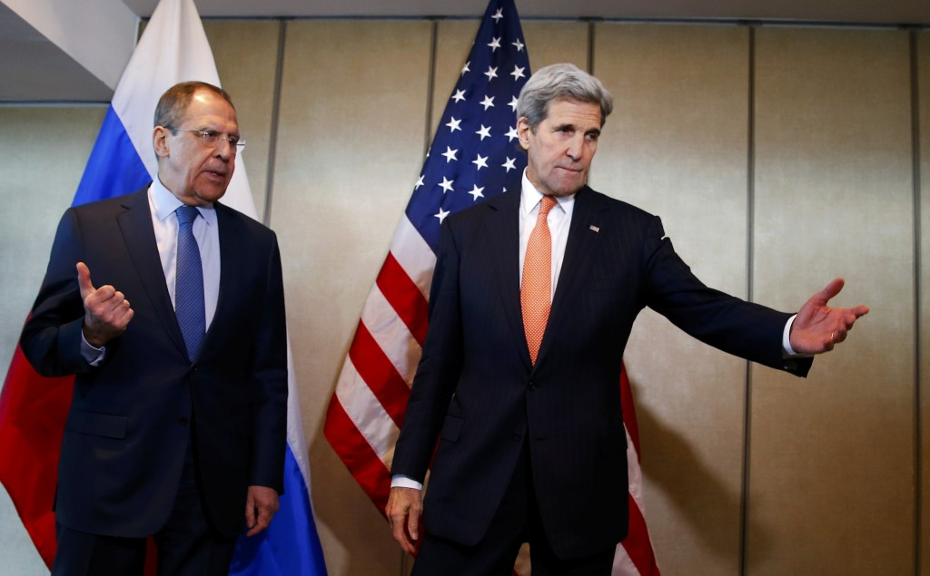 U.S. Foreign Secretary John Kerry and Russian Foreign Minister Sergei Lavrov gesture before their bilateral talks in Munich, Germany, February 11, 2016, ahead of the International Syria Support Group (ISSG) meeting. REUTERS/Michael Dalder