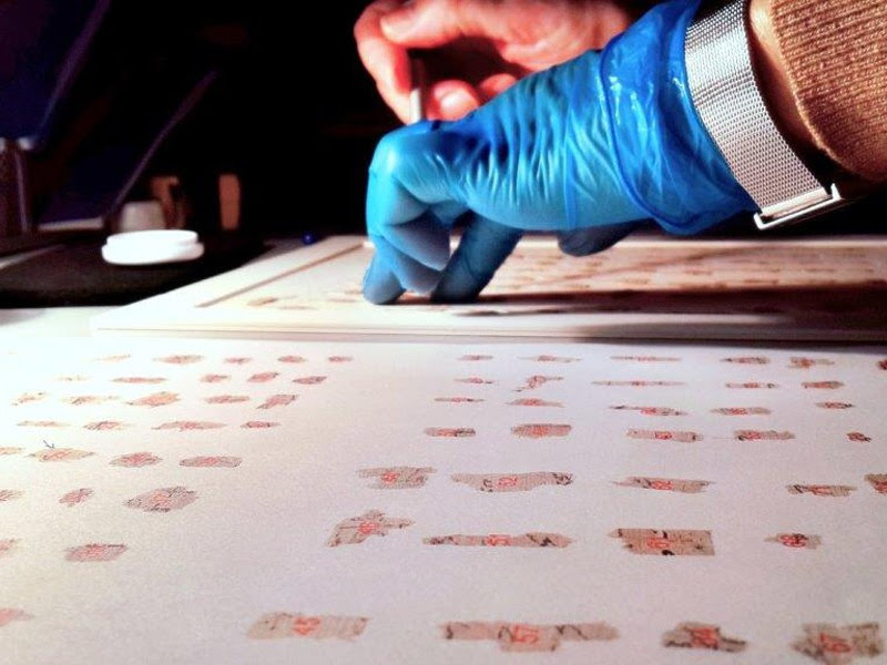 Thousands of the ancient scroll fragments from the conservation table to the virtual table. (Shai Halevi/Israel Antiquities Authority)
