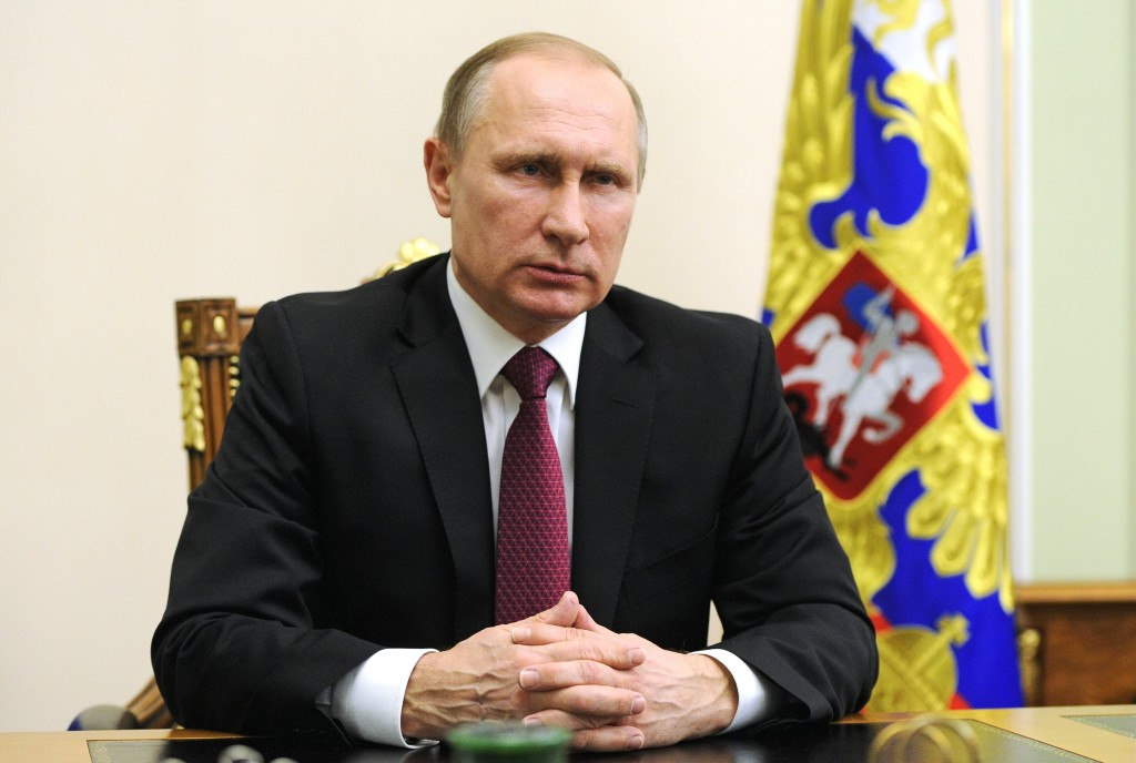 Russian President Vladimir Putin is seen during his speech with a special message after his telephone conversation with U.S. President Barack Obama at the Novo-Ogaryovo residence outside Moscow, Russia, Monday, Feb. 22, 2016. The U.N. special envoy for Syria, Staffan de Mistura, says the cease-fire reached by the United States and Russia and set to begin at midnight Saturday in Syria gives the two world powers the task of making sure that everyone else abides by it, too. (Mikhail Klimentyev/ Sputnik, Kremlin Pool Photo via AP)