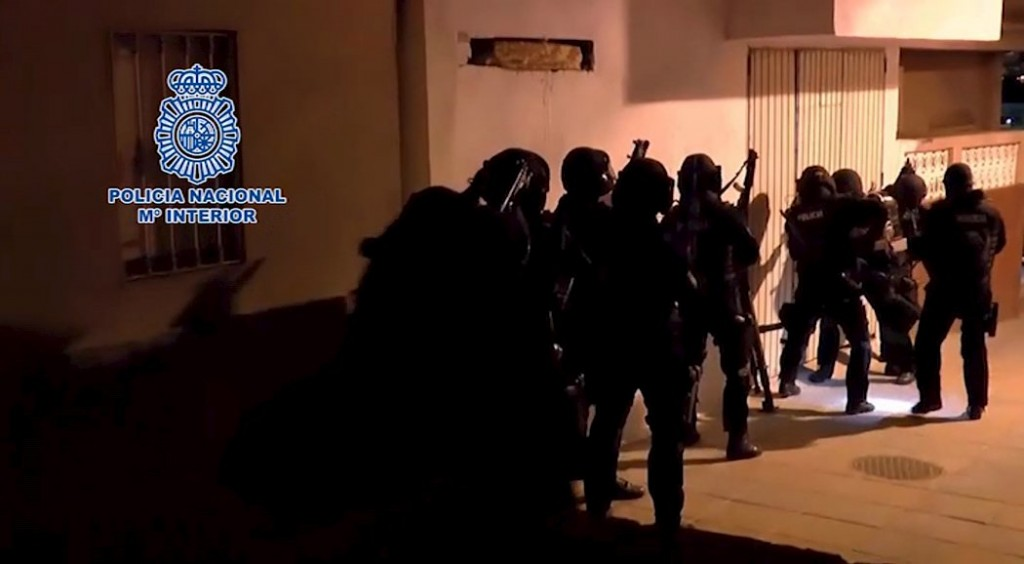 Spanish police prepare to enter a building during an operation in Spain's northern African enclave of Ceuta, in this still image from video released February 23, 2016. Spanish and Moroccan police arrested four people accused of recruiting potential militants to fight in Syria and Iraq or to carry out attacks in Spain or Morocco, the Interior Ministry said on Tuesday. Three Spaniards were detained in the Spanish enclave of Ceuta in northern Africa and one Moroccan in Nador, Morocco, as part of a joint operation between the two countries, the ministry said. REUTERS/Policia Nacional - Ministerio del Interior/Handout via Reuters TV ATTENTION EDITORS - THIS PICTURE WAS PROVIDED BY A THIRD PARTY. REUTERS IS UNABLE TO INDEPENDENTLY VERIFY THE AUTHENTICITY, CONTENT, LOCATION OR DATE OF THIS IMAGE. EDITORIAL USE ONLY. NOT FOR SALE FOR MARKETING OR ADVERTISING CAMPAIGNS. NO RESALES. NO ARCHIVE. THIS PICTURE IS DISTRIBUTED EXACTLY AS RECEIVED BY REUTERS, AS A SERVICE TO CLIENTS