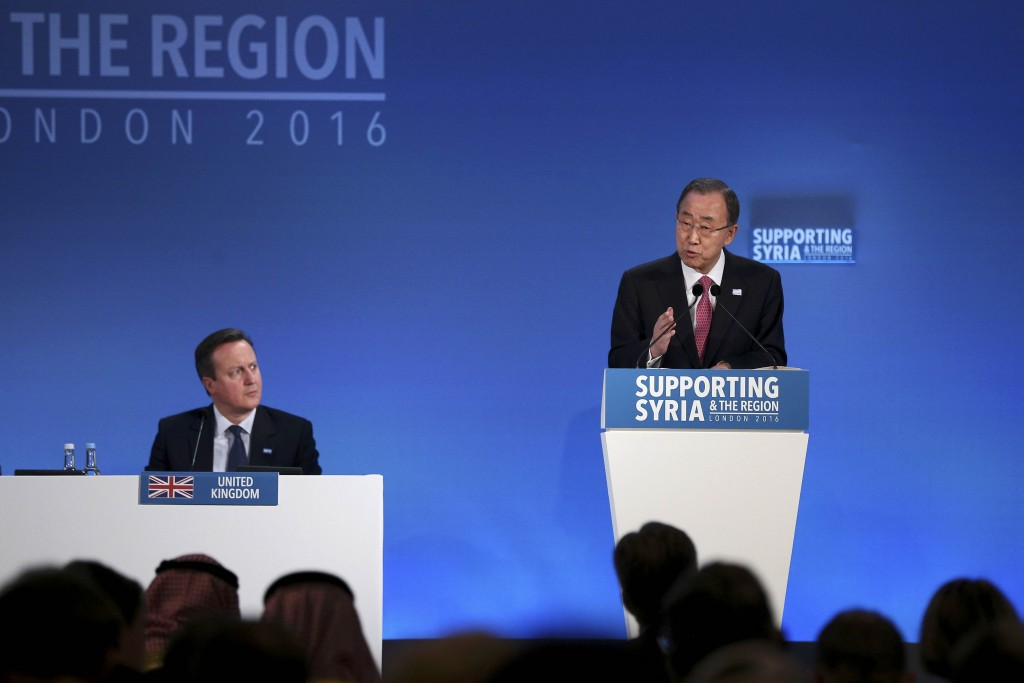 United Nations Secretary-General Ban Ki-moon speaks as Britain's Prime Minister David Cameron (L) listens at the donors Conference for Syria in London, Britain February 4, 2016. REUTERS/Dan Kitwood/pool
