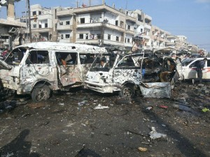Damaged buses are seen at the site of two bomb blasts in the government-controlled city of Homs, Syria. (Reuters/SANA/Handout via Reuters)