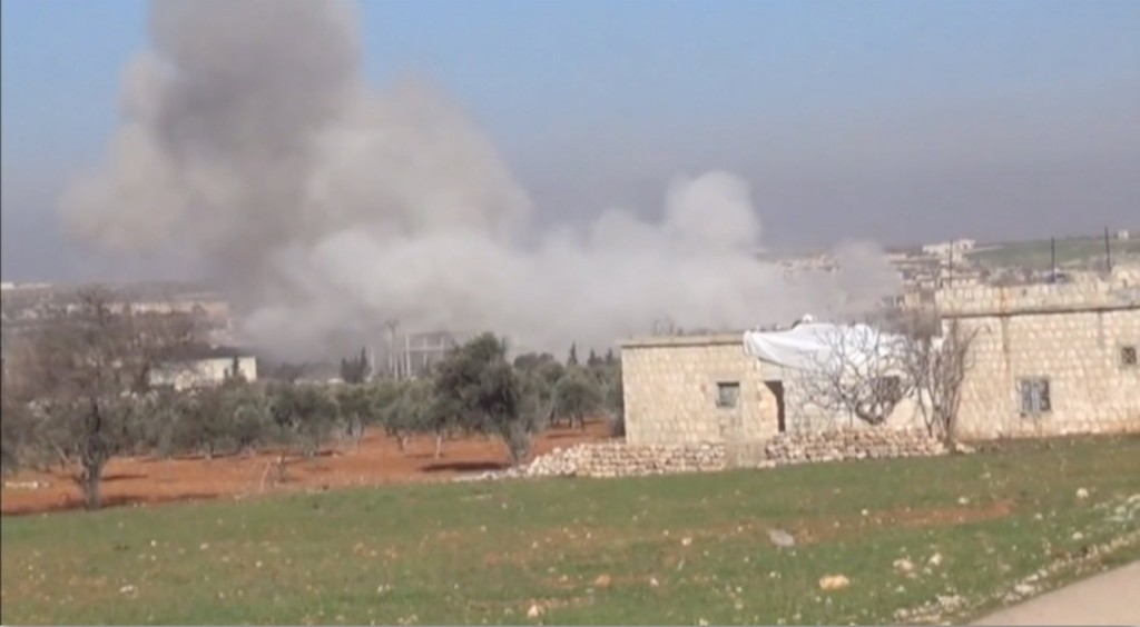 Smoke rises from a location said to be a Medecins Sans Frontieres (MSF) supported hospital in Marat al Numan, Idlib, Syria, February 15, 2016 in this still image taken from a video on a social media website. French charity Doctors Without Borders/Medecins Sans Frontieres (MSF) said in a statement that at least eight staff were missing after four rockets hit a hospital that it supported in the province of Idlib in north western Syria. REUTERS/Social Media Website via Reuters TVATTENTION EDITORS - THIS PICTURE WAS PROVIDED BY A THIRD PARTY. REUTERS IS UNABLE TO INDEPENDENTLY VERIFY THE AUTHENTICITY, CONTENT, LOCATION OR DATE OF THIS IMAGE. EDITORIAL USE ONLY. NOT FOR SALE FOR MARKETING OR ADVERTISING CAMPAIGNS. NO RESALES. NO ARCHIVE. THIS PICTURE IS DISTRIBUTED EXACTLY AS RECEIVED BY REUTERS, AS A SERVICE TO CLIENTS