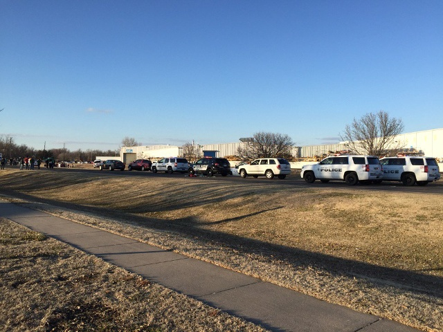 Police vehicles line the road after reports of a shooting in Hesston, Kan., Thursday, Feb. 25, 2016. A Harvey County sheriff's dispatcher said the shooting occurred Thursday afternoon at Excel Industries. (KWCH-TV via AP)