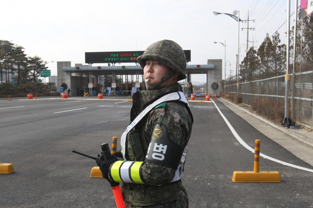 A South Korea Army soldier stands guard at the customs, immigration and quarantine office near the border village of Panmunjom, in Paju, South Korea, Thursday, Feb. 11, 2016. South Korean workers on Thursday began shutting down a jointly run industrial park in North Korea, a move that will end, at least temporarily, the Koreas' last major cooperation project as punishment over Pyongyang's recent rocket launch. (AP Photo/Ahn Young-joon)