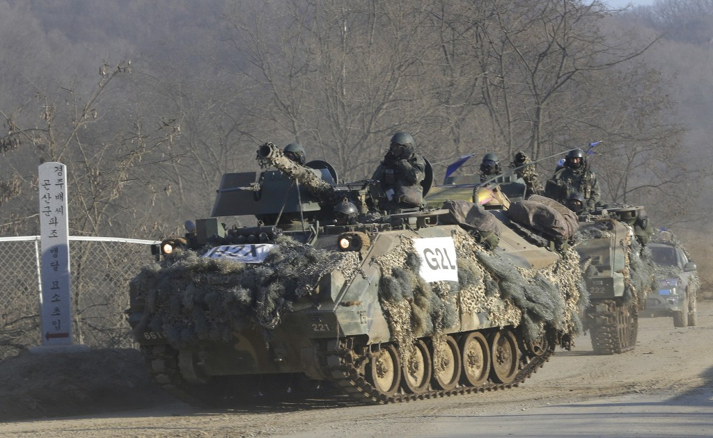 South Korean army's armored vehicles move during the annual exercise against possible North Korea's attack in Paju, near the border with North Korea, Wednesday, Feb. 24, 2016. Carved in two by the Soviets and Americans at the end of WWII, the halves of the Korean Peninsula fought a vicious war in the early 1950s, and have spent much of the years since then promising, and sometimes trying very hard to engineer, each other's destruction. (AP Photo/Ahn Young-joon)