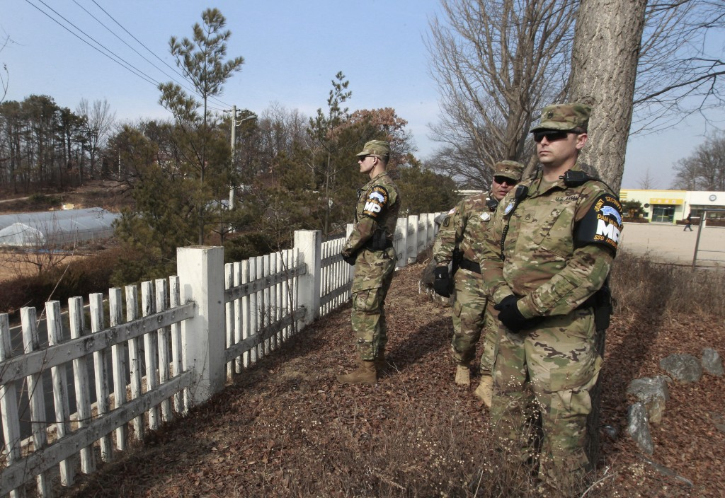 U.S. Army soldiers stand guard at Taesungdong freedom village near the border village of Panmunjom in Paju, South Korea, Thursday, Feb. 4, 2016. South Korea and Japan vowed to shoot down any debris that falls on their territories from a long-range rocket that North Korea plans to fire this month, with Seoul saying Thursday that it has detected launch preparations by Pyongyang. (AP Photo/Ahn Young-joon)