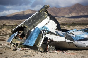In this Nov. 1, 2014 file photo, wreckage lies near the site where a Virgin Galactic space tourism rocket, SpaceShipTwo, crashed in the desert near Mojave, Calif. (AP Photo/Ringo H.W. Chiu, File)