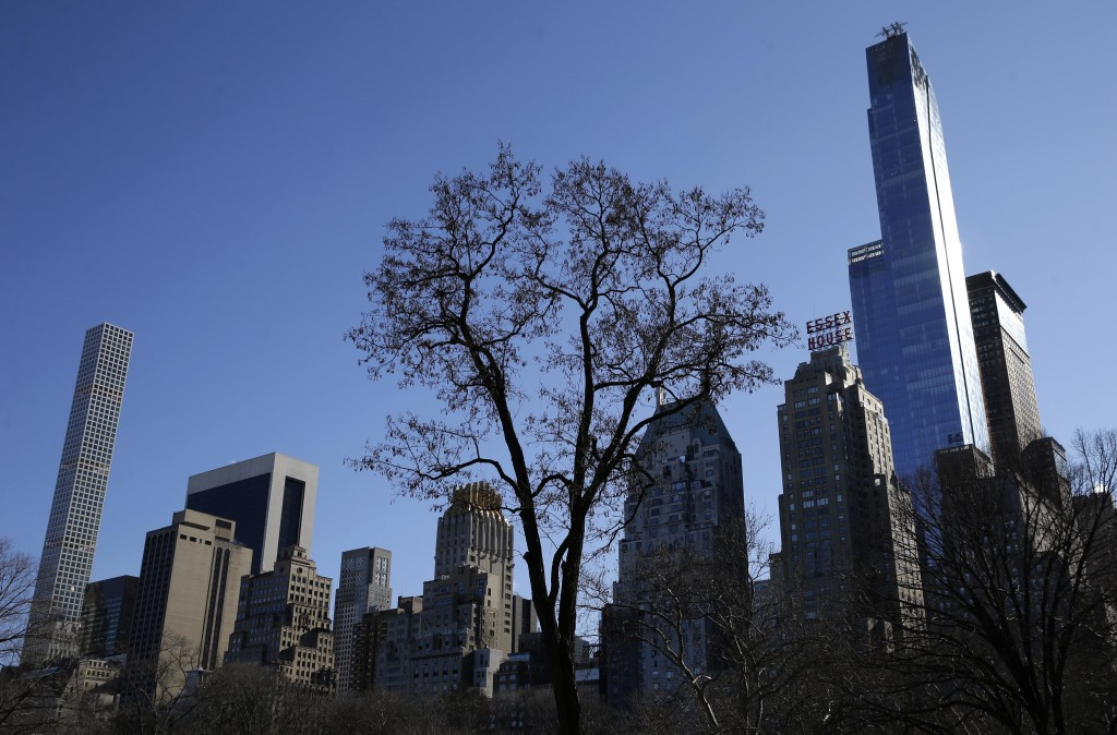 Two supertall skyscrapers, 157 W. 57th St, right, and 432 Park Ave, left, are seen from central Park. (AP Photo/Seth Wenig)