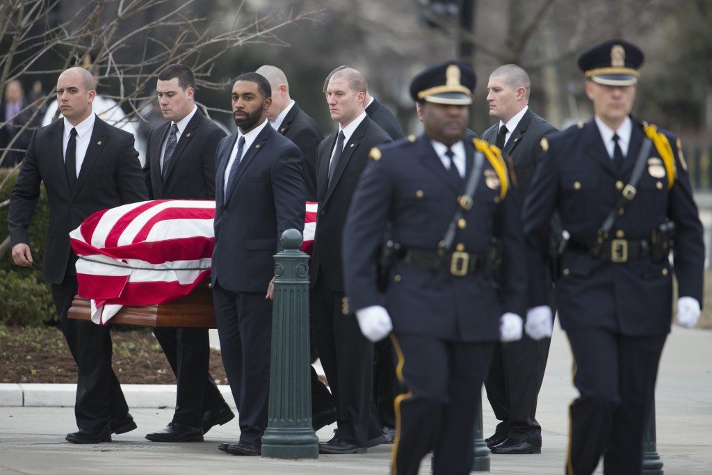 The casket of the late Justice Antonin Scalia arrives at the Supreme Court on Friday morning. (AP Photo/Evan Vucci)