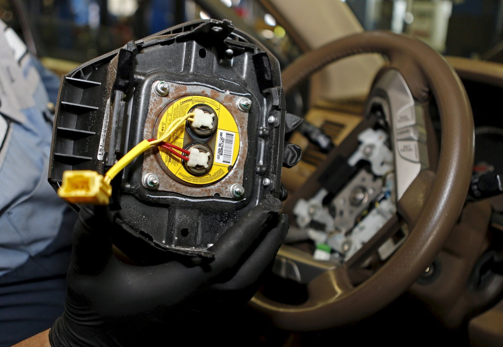 A technician holds a recalled Takata airbag inflator after he removed it from a Honda Pilot at the AutoNation Honda dealership service department in Miami, Florida June 25, 2015. Takata is expected to report Q3 results this week. REUTERS/Joe Skipper/Files GLOBAL BUSINESS WEEK AHEAD PACKAGE - SEARCH 'BUSINESS WEEK AHEAD FEBRUARY 1' FOR ALL IMAGES