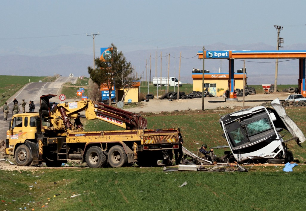 A military vehicle, damaged by a remote control bomb, is pictured near Diyarbakir, Turkey February 18, 2016. A bomb detonated by remote control killed seven Turkish security force members travelling in a military vehicle in southeast Turkey on Thursday, security sources said, a day after a car bomb attack in the capital Ankara killed 28 people. The blast hit the armoured vehicle on the highway linking Diyarbakir, the largest city in the mainly Kurdish southeast, to the district of Lice. Sources had previously said the explosion hit a convoy of vehicles. REUTERS/Sertac Kayar
