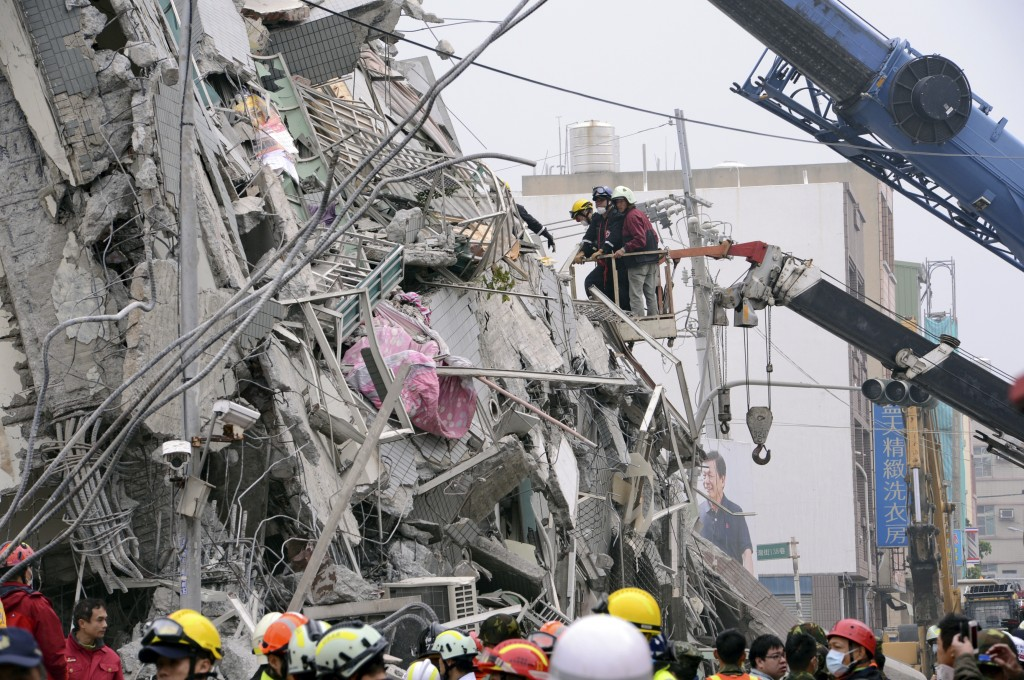 In this photo released by China's Xinhua News Agency, rescuers search for survivors at a quake site in Tainan, Taiwan Saturday, Feb. 6, 2016. (Zhang Guojun/Xinhua via AP)