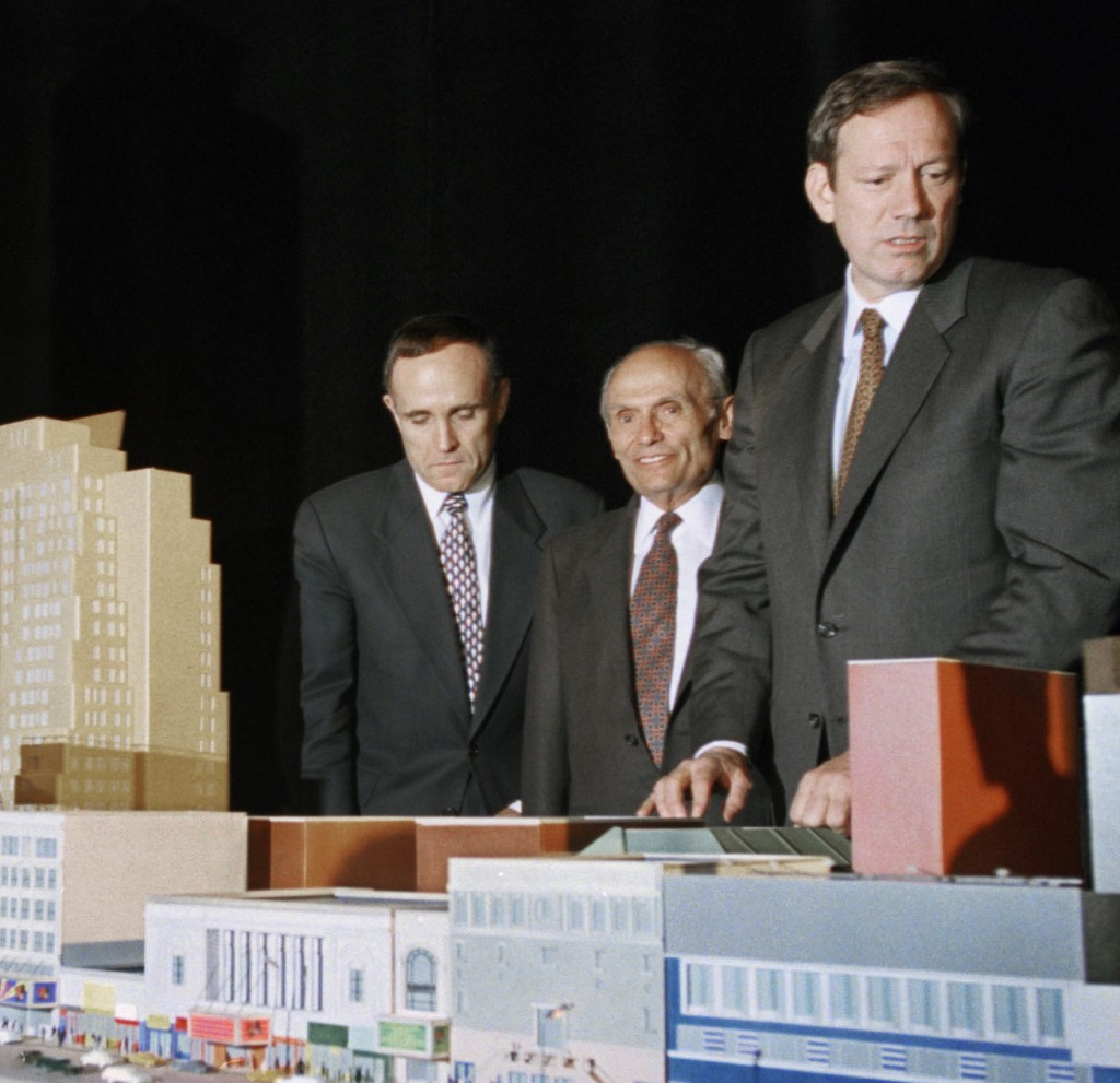 NYC Mayor Rudolph Giuliani, (L), developer John Tishman, (C), and Gov. George Pataki, pose in 1995 with the scale model of the 42nd Street development project. (AP Photo/Bebeto Matthews, File)