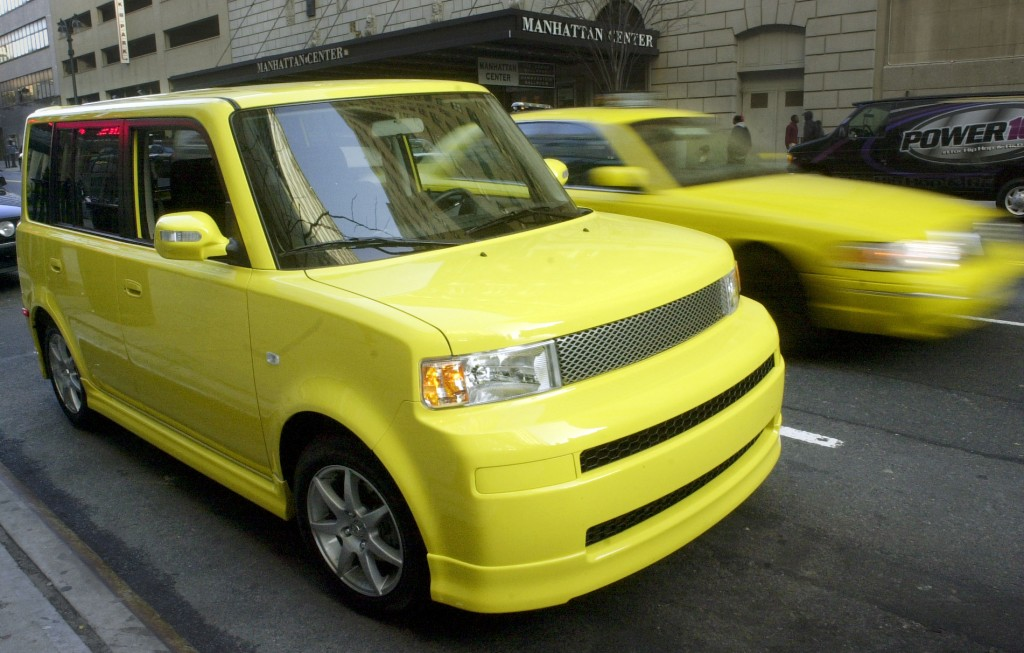 In this April 16, 2005 photo, a solar yellow Scion limited-production xB Release Series 2.0 is parked in Manhattan as part of a corporate promotion in New York. (AP Photo/Mark Lennihan, File)