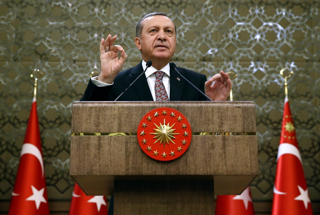 "Turkish President Recep Tayyip Erdogan addresses a meeting of local administrators at his palace in Ankara, Turkey, Wedesday, Feb. 10, 2016. Erdogan has ratcheted up his criticism of the United State for not recognizing Syrian Kurdish forces as ""terrorists,"" saying Washington's lack of knowledge of the groups operating in the region had led to bloodshed. Turkey considers the Kurdish Democratic Union Party, or PYD, which are affiliated with Turkey's own Kurdish rebels as a terrorist group. (Yasin Bulbul/Presidential Press Service, Pool via AP)"