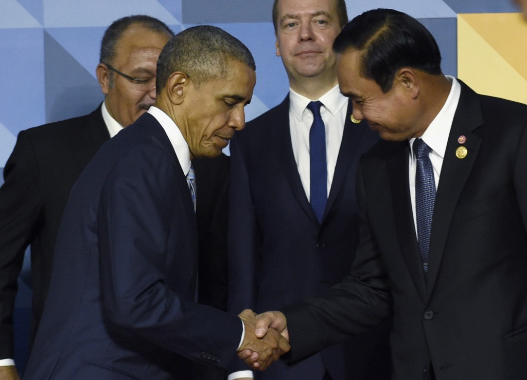 FILE - In this Nov. 19, 2015 file photo, President Barack Obama shakes hands with Thailand's Prime Minister Prayuth Chan-ocha in Manila, Philippines. When President Barack Obama welcomes Southeast Asian leaders for a shirt-sleeves summit in California this week, he'll have some interesting dining companions. There will be a coup leader with a penchant for song, a sultan with a taste for the high life and a ruthless prime minister with 31 years on the job. (AP Photo/Susan Walsh, File)