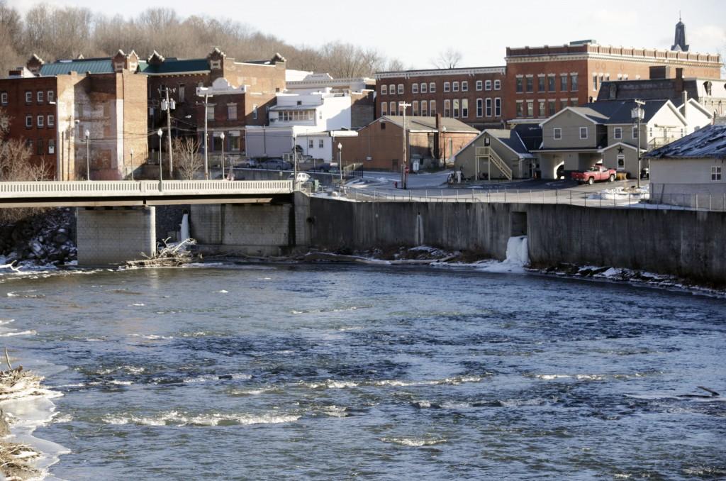 The Hoosic River runs through the village of Hoosick Falls, N.Y. (AP Photo/Mike Groll, File)
